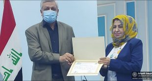 A teacher from the Faculty of Engineering, University of Kufa, participates in the workshop organized by the Ministry of Health and Environment